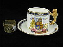 A Paragon china cup and saucer commemorating the coronation of King Edward VIII and a brass napkin ring