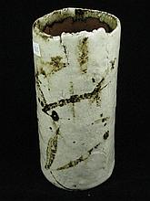 A glazed artisan ceramic cream vase with M3 marked to the base