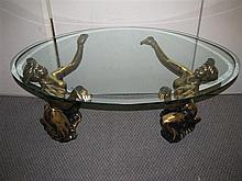 A figural glass topped coffee table