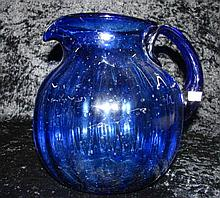 A large blue studio glass jug