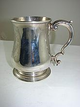 A George II sterling silver tankard London 1748