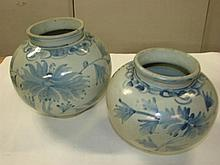 A set of two graduated blue and white jars