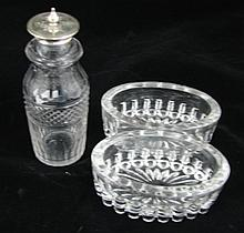 A pair of glass salts and crystal pepper with silver plated mount