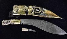 A reproduction Gurkha knive and highly decorated scabbard plus one small matching knife