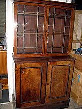 An antique mahogany bookcase