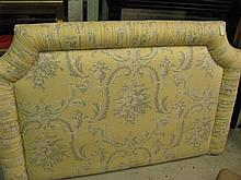A queen size upholstered bed