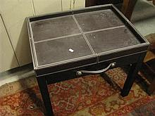 A leather table with one drawer