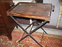 A wooden butlers table with metal stand