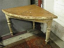 An antique wooden corner table