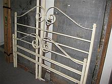 A white wrought iron bed