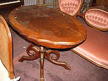 A Victorian centre table in walnut and mahogany