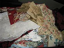 A suitcase of assorted linens and fabrics