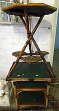 A two tier cane table along with a folding cane table