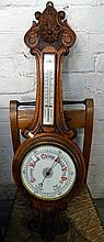 An antique oak Victorian barometer/thermometer