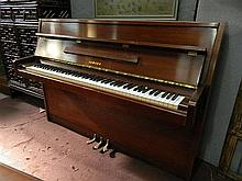 A modern Yamaha upright piano serial number 3403112