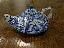A blue and white porcelain miniature tea pot