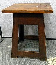 A small vintage oak stool