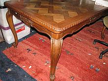 A vintage oak draw leaf table