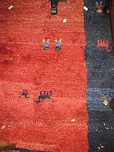 A tribal rug - red and blue tones with Lama motif