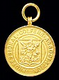 A 9ct. gold PGA medal presented to Ted Ray the