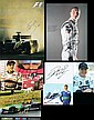 A collection of Formula 1 driver-signed printed