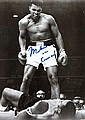 A Muhammad Ali signed b&w; photograph of him