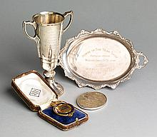 A 1953 Royal Dublin Society Horse Show winner's prize medal for The Aga Khan Trophy (team of four) awarded to W.H. White (England) on
