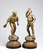 A pair of French 19th century spelter figures with the unusual sporting subject of jeu de balle au tambourin,