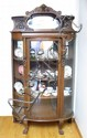 LION HEAD GOLDEN OAK BOW FRONT CHINA CABINET