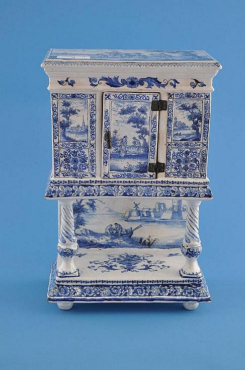 An antique Delft blue and white pottery cabinet on