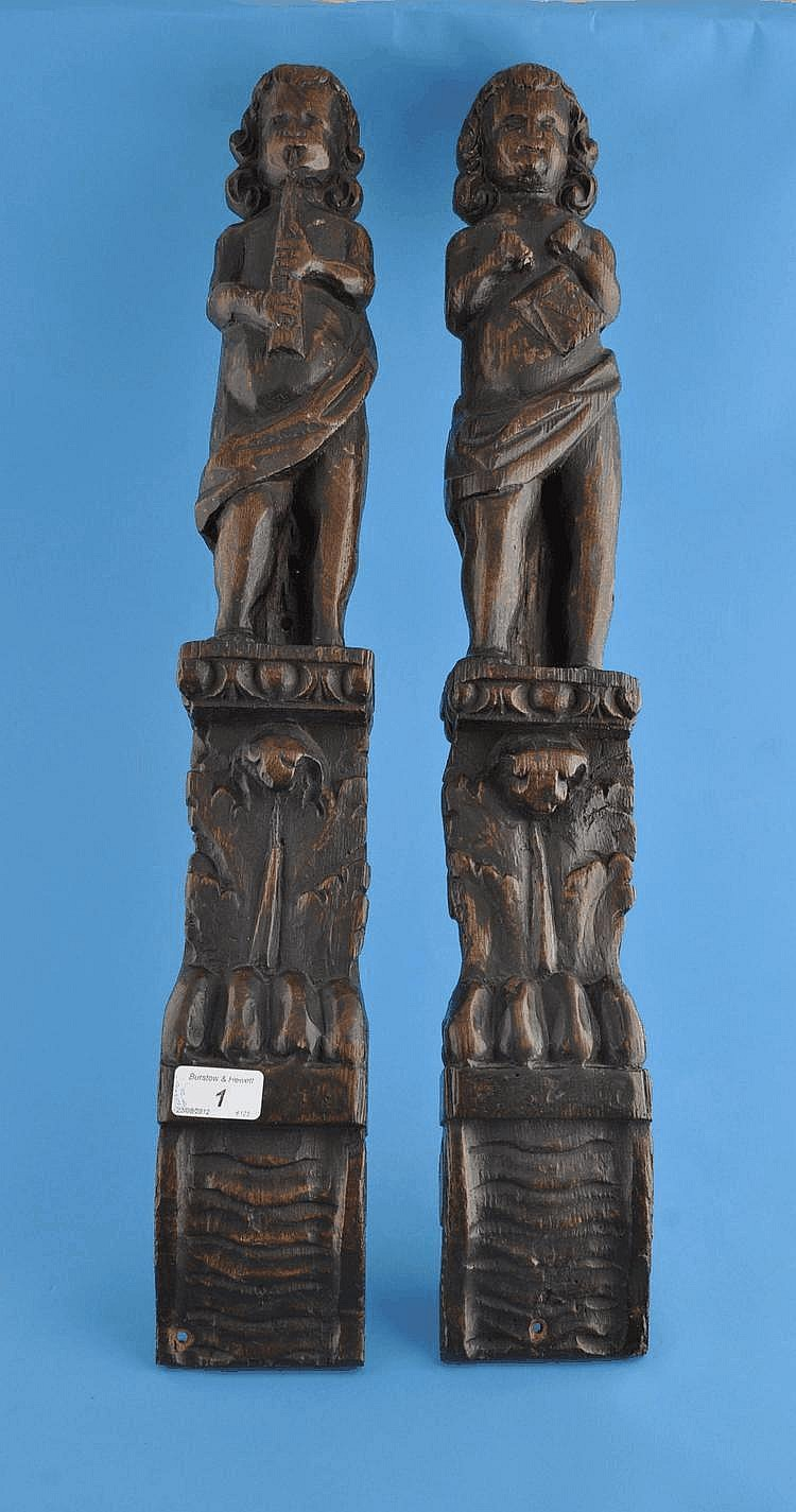 A pair of Antique carved oak cherub musician