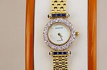 14kt Ladies gold, diamond & sapphire Geneve watch