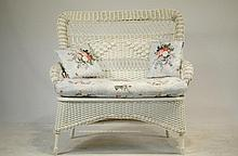 Wicker love seat with pillows