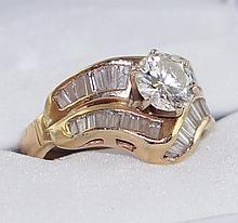14kt Gold 1.25 center stone diamond ring