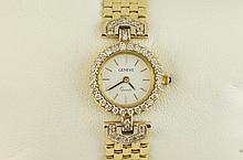 14kt Ladies gold & diamond Geneve watch