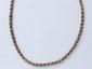 Chaîne en or 14 k, composée de maillons losangiques, agrémentée d'un fermoir à cliquet.. Poids: 19.60 g. Long: 43.5 cm.