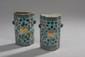 Chine. Paire de porte bouquet en porcelaine à décor floral polychrome et or sur fond vert. (fels, manque un bac en zinc). H. 14 - L. 7.5 cm. /5