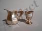 Salière ovale en argent quadripode, la monture ajourée de pilastres, grilles, fleurs de lys et chutes de fleurs sur un fond amati.. Paris 1786-89 (avec un intérieur en verre bleu).. On y joint un crémier à pans, 2 salières ovales, une ronde et 4