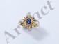 Bague en or, ornée d'un saphir ovale facetté en serti clos, rehaussé de diamants brillantés.. Poids brut: 6.70 g. TDD: 56. (égrisures)