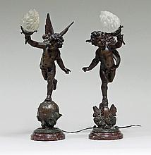 A pair of spelter cherub table lights, 48.25cm (19