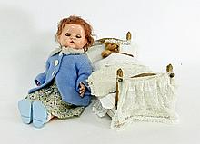 A composition doll, a doll's bed with linen and a