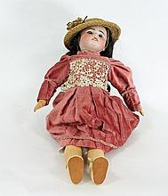 A French bisque head doll, SFBJ Paris, with weight