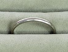 A platinum wedding band, ring size Q, approximatel