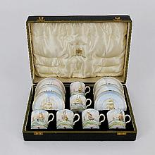 A set of six Royal Crown Derby coffee cans and sau