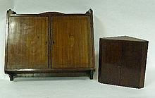 An Edwardian wall hanging cabinet enclosed by two