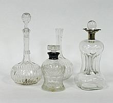 An hourglass shaped decanter with stopper, the sil