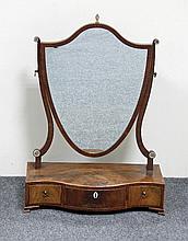 A George III serpentine three-drawer box mirror wi