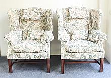 A pair of George III style upholstered wing armcha