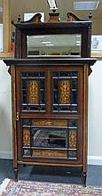 An Edwardian rosewood and inlaid music cabinet wit