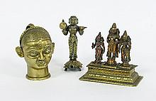 An Indian brass lingam cover, modelled as a head,